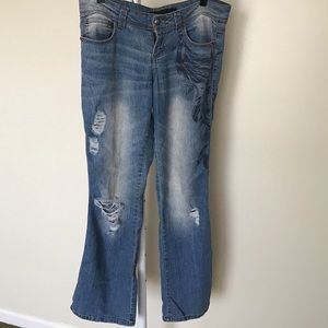 Printed destroyed boot jeans